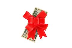 Dollars under a red bow on white Royalty Free Stock Photo