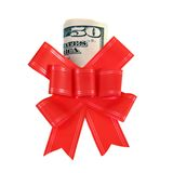 Dollars under a red bow on white Stock Photo