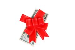 Dollars under a red bow on white Stock Image