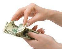 Dollars US Chez la main de la femme, d'isolement Photos stock