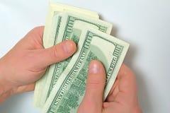 Dollars US d'argent liquide à disposition Images stock