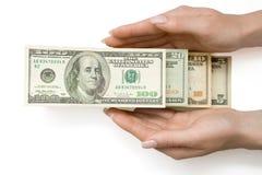 Dollars US Dans l'échelle chez la main de la femme, d'isolement Photo libre de droits