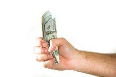 Dollars US de devise Une poignée maintenue avec l'argent Photos stock