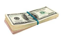 Dollars US Enveloppés par le caoutchouc Photographie stock