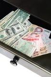 Dollars US et bahts thaïs Images stock