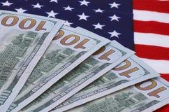 Dollars on USA flag Stock Photos