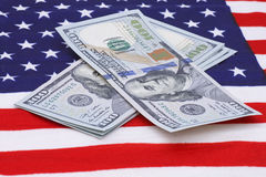 Dollars on USA flag Stock Images