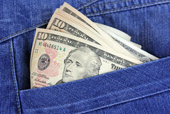 Dollars of USA sticking out of his jeans Stock Image
