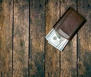 Dollars in the wallet. On table royalty free stock photo