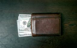 Dollars in the wallet. On table stock photography