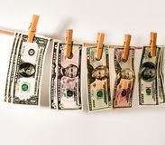 Dollars weigh on the rope.  Stock Photo