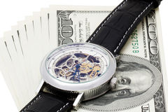 100 dollars on white background with wristwatches Stock Image