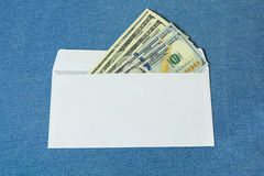 Dollars in a white envelope. Stock Images