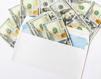 The dollars in an envelope is isolated on a white background royalty free stock photography