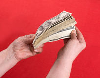 Dollars in woman's hands Royalty Free Stock Photos