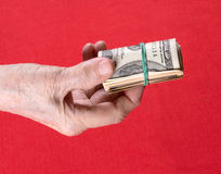 Dollars in woman's hands Stock Image
