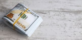 Dollars on wooden background stock image