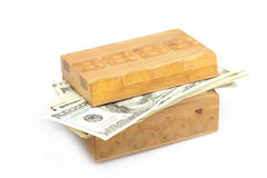 Dollars in the wooden box Royalty Free Stock Photo