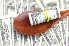 Dollars in the wooden spoon Royalty Free Stock Photography