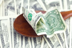 Dollars in the wooden spoon Royalty Free Stock Photos