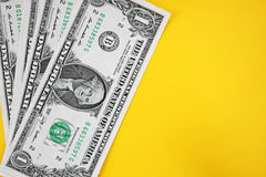 Dollars on yellow backgroudn. Stock Image