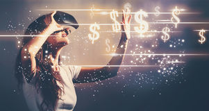 Dollars with young woman with VR Royalty Free Stock Image