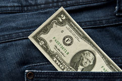 Dollars in your pocket. American dollars USD banknote in jeans pocket Stock Photos