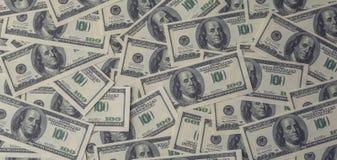Dollarsachtergrond, hoop van honderd rekeningen van het de dollarbankbiljet van de V.S., veel Amerikaans contant geldgeld Stock Fotografie