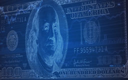 100 Dollarschein auf einem Börse-Diagramm Stockfotos