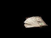 Dollarschein auf einem schwarzen Hintergrund Stockbilder