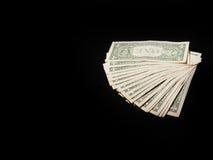 Dollarschein auf einem schwarzen Hintergrund Stockfotos