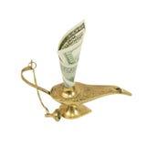 Dollarschein, der aus Wunderlampe von Aladdin heraus haftet Stockfoto