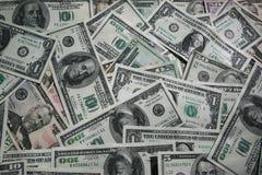 Dollarschein-Geldhintergrund Stockfotos