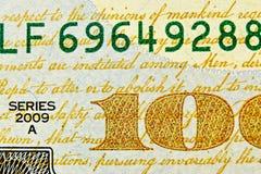Dollarscheinabschluß oben mit Goldtext lizenzfreie stockfotos