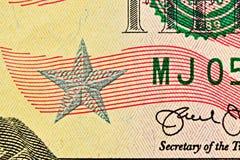 Dollarscheinabschluß oben mit silbernem Stern und sichtbarer Faser in Papier lizenzfreies stockfoto