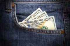 Dollarsedlar i fick- closeup för jeans äganderätt för home tangent för affärsidé som guld- ner skyen till blåa pengar för jeans f Arkivbilder