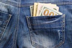 Dollarsedlar i fick- closeup för jeans äganderätt för home tangent för affärsidé som guld- ner skyen till blåa pengar för jeans f Royaltyfri Fotografi