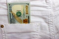 Dollarsedlar i fick- closeup för jeans äganderätt för home tangent för affärsidé som guld- ner skyen till blåa pengar för jeans f Arkivbild