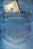 Dollarsedlar i fick- closeup för jeans Arkivfoto