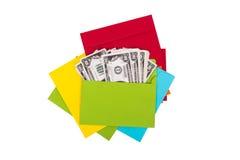 Dollarsedlar inom kuvert arkivfoton