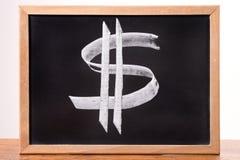 Dollartecken på en svart tavla Arkivfoton