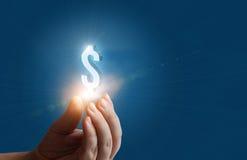 Dollarteken in de hand van zakenman Stock Fotografie