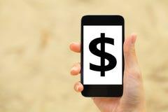 Dollarteken op mobiele telefoon Royalty-vrije Stock Afbeeldingen