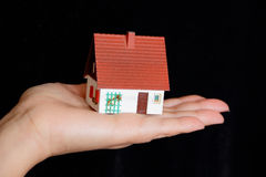 Dollhouse in human hand Stock Photos