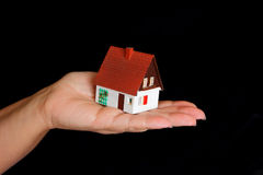 Dollhouse in human hand Stock Photography