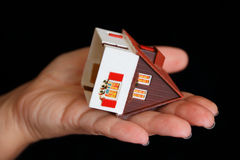 Dollhouse in human hand Royalty Free Stock Photography