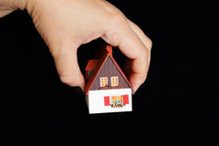 Dollhouse in human hand Stock Photo