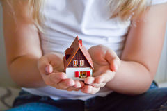 Dollhouse in human hand Royalty Free Stock Photo