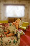 Dollhouse livingroom and doll Stock Image