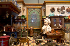 Dollhouse. Vintage dollhouse kitchen with a boy Stock Photography